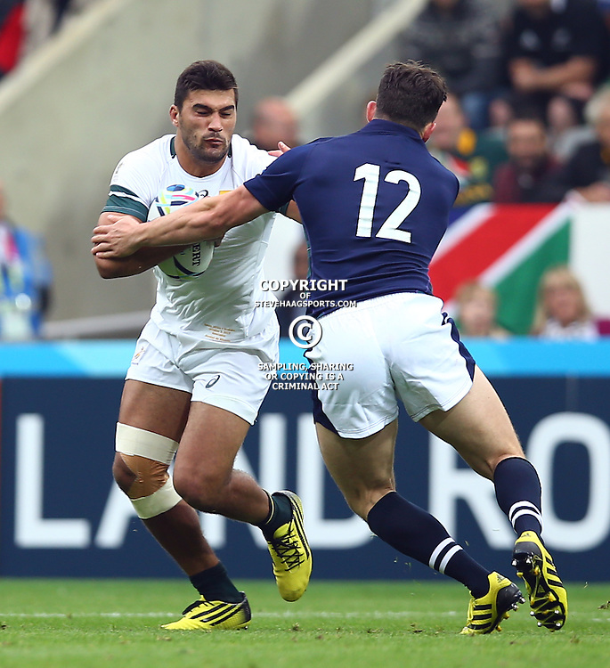 NEWCASTLE UPON TYNE, ENGLAND - OCTOBER 03: Matt Scott of Scotland looks to tackle Damian De Allende of South Africa during the Rugby World Cup 2015 Pool B match between South Africa and Scotland at St James Park on October 03, 2015 in Newcastle upon Tyne, England. (Photo by Steve Haag/Gallo Images)