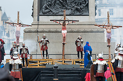 """© Licensed to London News Pictures. 30/03/2018. LONDON, UK. (C) Jesus, played by James Burke-Dunsmore, is crucified. The Wintershall Players present their traditional """"The Passion of Jesus"""" play in Trafalgar Square on Good Friday in front of large crowds despite the heavy rain.  The play brings to life the events leading to the crucifixion of Jesus Christ, played by James Burke-Dunsmore, and his subsequent resurrection.  Photo credit: Stephen Chung/LNP"""
