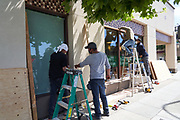 Businesses board up their storefronts after days of protests and looting in the San Francisco Bay Area, photographed in Redwood City, California, on June 2, 2020. (Stan Olszewski for ZUMA Press)