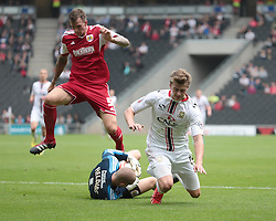 Milton Keynes Dons' Patrick Bamford falls over Bristol City Goalkeeper, Frank Fielding  - Photo mandatory by-line: Nigel Pitts-Drake/JMP - Tel: Mobile: 07966 386802 24/08/2013 - SPORT - FOOTBALL - Stadium MK - Milton Keynes - Milton Keynes Dons V Bristol City - Sky Bet League One