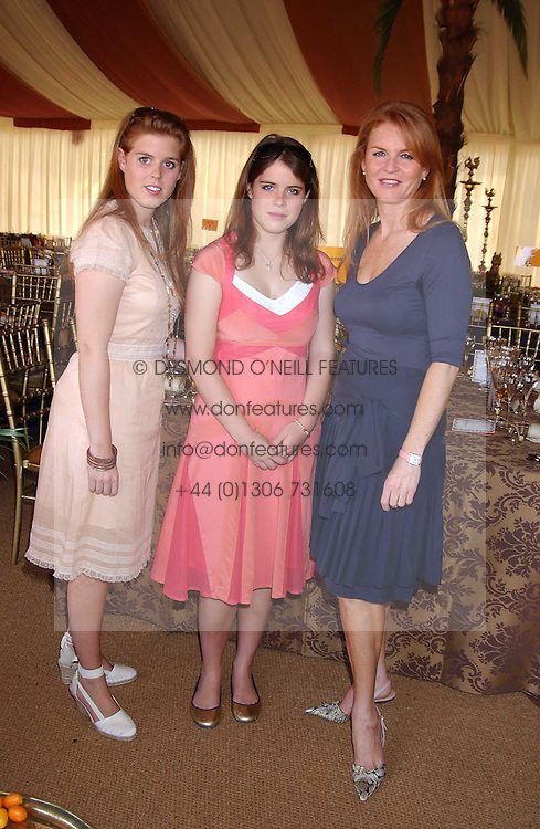 Left to right, HRH PRINCESS BEATICE OF YORK, HRH PRINCESS EUGENIE OF YORK and their mother SARAH, DUCHESS OF YORK at the Veuve Clicquot sponsored Gold Cup Final or the British Open Polo Championship held at Cowdray Park, West Sussex on 17th July 2005.<br />