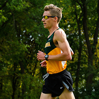 Adam Strueby competes during the annual Cougar Trot on September 17 at Douglas Park. Strueby went on to win the 8K race in a time of 25:39. Credit: Arthur Ward/Arthur Images