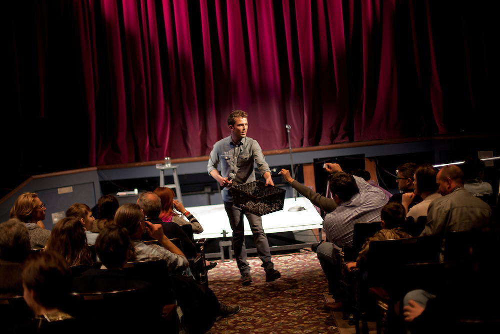 Iowa magician Nate Staniforth collects cards from audience members as he performs a magic trick at The Englert Theater in Iowa City, Iowa on Friday, November 6, 2015 during the Witching Hour Festival. He says that his greatest fear is that it will become more difficult to be astonished as he grows older.