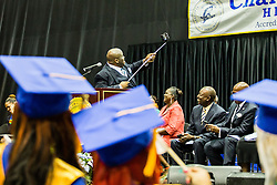 Principal Stefan V. Jürgen takes a selfie with the senior class behind him.  Charlotte Amalie High School 85th Annual Commencement Program at UVI Sports and Fitness Center.  14 June 2015.  © Aisha-Zakiya Boyd