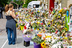 © Licensed to London News Pictures. 01/07/2017. London, UK. People lay flowers for the victims of the Grenfell Tower fire on Saturday, 1 July 2017 at Notting Hill methodist church in west London. Photo credit: Tolga Akmen/LNP