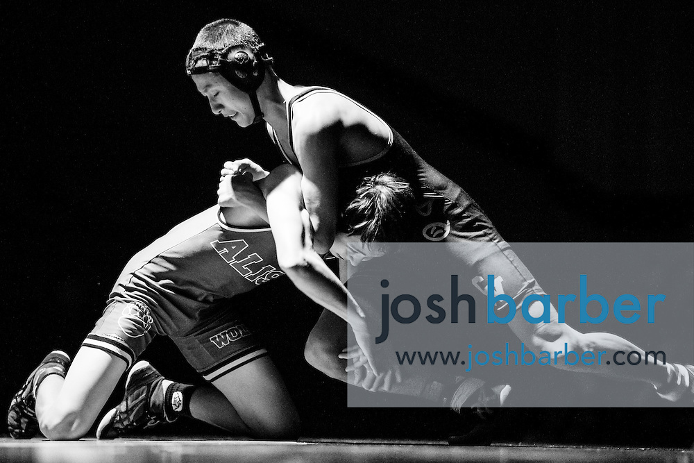 Aliso Niguel's Chris Le, Capistrano Valley's Rick Wang during Sea View league wrestling at Capistrano Valley High School on Thursday, January 14, 2016 in Mission Viejo, California. Capistrano Valley won 43-22. (Photo/Josh Barber)