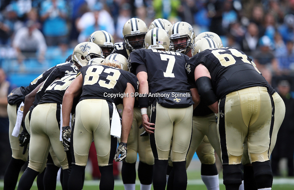 the New Orleans Saints offense huddles and calls a play during the 2015 NFL week 3 regular season football game against the Carolina Panthers on Sunday, Sept. 27, 2015 in Charlotte, N.C. The Panthers won the game 27-22. (©Paul Anthony Spinelli)