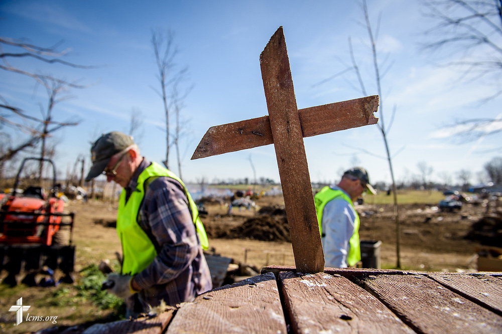 Volunteers erect a small cross at a destroyed home on Saturday, March 4, 2017, in Perryville, Mo. Tornadoes tore through the town earlier in the week. LCMS Communications/Erik M. Lunsford