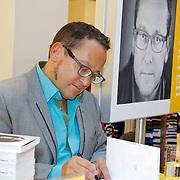 NLD/Amsterdam/20120310 - Feest der Letteren 2012 , Tom Lanoye signeert boek