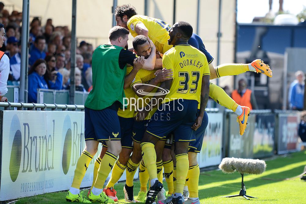 Kemar Roofe celebrates goal with team mates during the Sky Bet League 2 match between Bristol Rovers and Oxford United at the Memorial Stadium, Bristol, England on 6 September 2015. Photo by Alan Franklin.