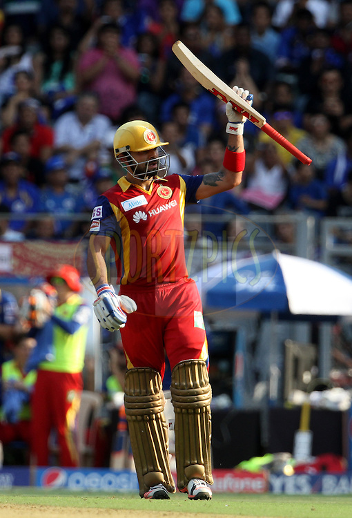 Royal Challengers Bangalore captain Virat Kohli raises his bat after scoring a fifty during match 46 of the Pepsi IPL 2015 (Indian Premier League) between The Mumbai Indians and The Royal Challengers Bangalore held at the Wankhede Stadium in Mumbai, India on the 10th May 2015.<br /> <br /> Photo by:  Vipin Pawar / SPORTZPICS / IPL