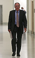 Senator Tom Harkin (D-IA) walks down the hallway of the Rayburn House Office Building on his way to a reception in Washington, DC on Wednesday, April 10, 2013.