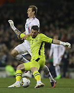 Keiren Westwood of Republic of Ireland clears under pressure from Jon Dadi Bodvarsson of Iceland during the International Friendly match at the Aviva Stadium, Dublin<br /> Picture by Lorraine O'Sullivan/Focus Images Ltd +353 872341584<br /> 28/03/2017