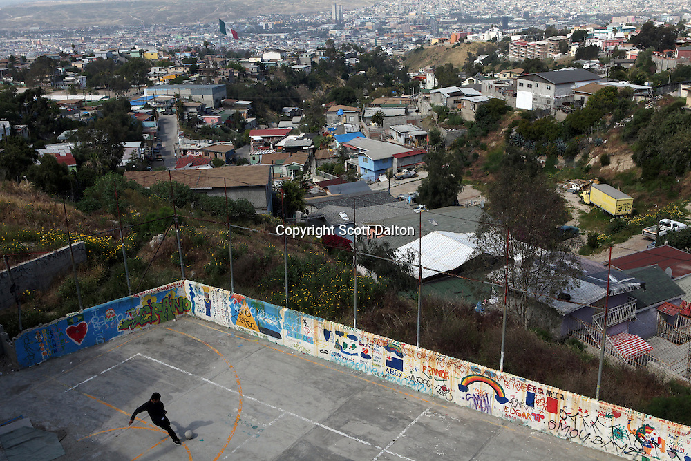 A boy plays soccer in a barrio overlooking Tijuana, Mexico on April 27, 2010. (Photo/Scott Dalton)