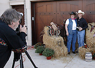 Jerry Huffman of Centerville (left) takes the photo of Julie and Chris Snyder during the 2010 Cattle Baron's Ball at the home of David and Shery Oakes in Centerville, Saturday, August 28, 2010.