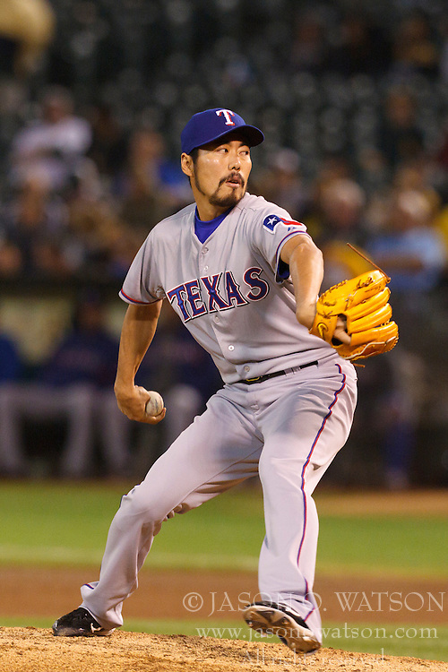 September 21, 2011; Oakland, CA, USA;  Texas Rangers relief pitcher Koji Uehara (19) pitches against the Oakland Athletics during the seventh inning at O.co Coliseum. Texas defeated Oakland 3-2.