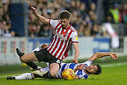Brentford defender Chris Mepham (6) tackled by QPR midfielder Massimo Luongo (21) during the EFL Sky Bet Championship match between Queens Park Rangers and Brentford at the Loftus Road Stadium, London, England on 10 November 2018.