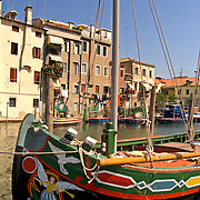 Fishing boats moored along Vena canal in Chioggia Italy