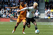 Derby County midfielder Will Hughes battles with Hull City midfielder Ahmed Elmohamady during the Sky Bet Championship play-off first leg match between Derby County and Hull City at the iPro Stadium, Derby, England on 14 May 2016. Photo by Alan Franklin.