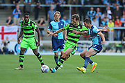 Forest Green Rovers Christian Doidge(9) clears the ball under pressure from Wycombe Wanderers Matthew Bloomfield(10) during the EFL Sky Bet League 2 match between Wycombe Wanderers and Forest Green Rovers at Adams Park, High Wycombe, England on 2 September 2017. Photo by Shane Healey.