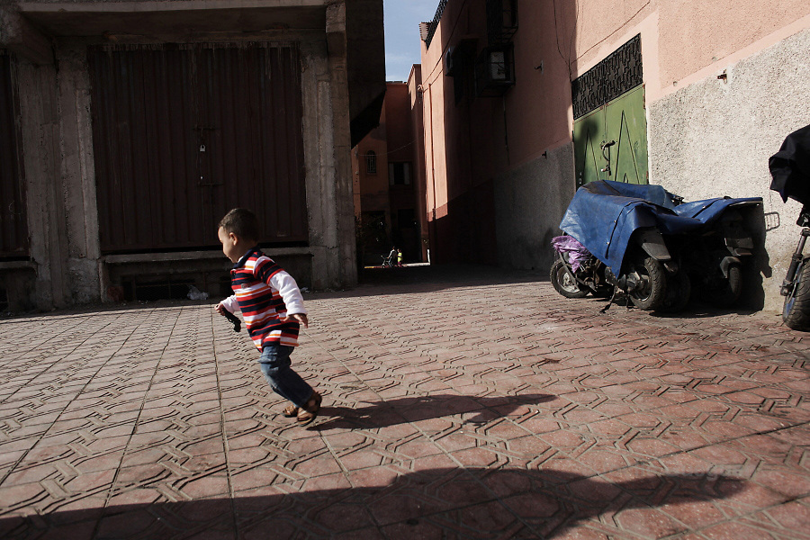 Mohammed 2 years old plays in the street  under the surveillance of  his mum, Saida, single mother of 32 years old near their home. Living in a single room of 12 square meters, Mohammed takes any opportunity to run and play when he has the space.  -   Marrakech Daoudiat district - 4 May 2013