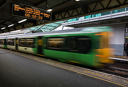 CAPTION CORRECTION © Licensed to London News Pictures. 19/12/2016. London, UK. A Southern Rail train speed through  Clapham Junction. Some Southern Rail services are running today as ASLEF union drivers started a two day strike in a dispute over driver-only operated trains. Photo credit: Peter Macdiarmid/LNP