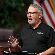 City of Orlando Mayor Buddy Dyer speaks during a press conference about the spreading Coronavirus (Covid-19) hotspots in the City of Orlando, at the Orange County Administration Center on Friday, April 3, 2020 in Orlando, Florida. (Alex Menendez via AP)