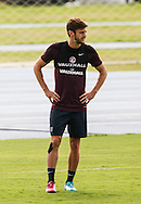 Adam Lallana looks on during the England training session at Est&aacute;dio Claudio Coutinho, Rio de Janeiro, Brazil<br /> Picture by Andrew Tobin/Focus Images Ltd +44 7710 761829<br /> 21/06/2014