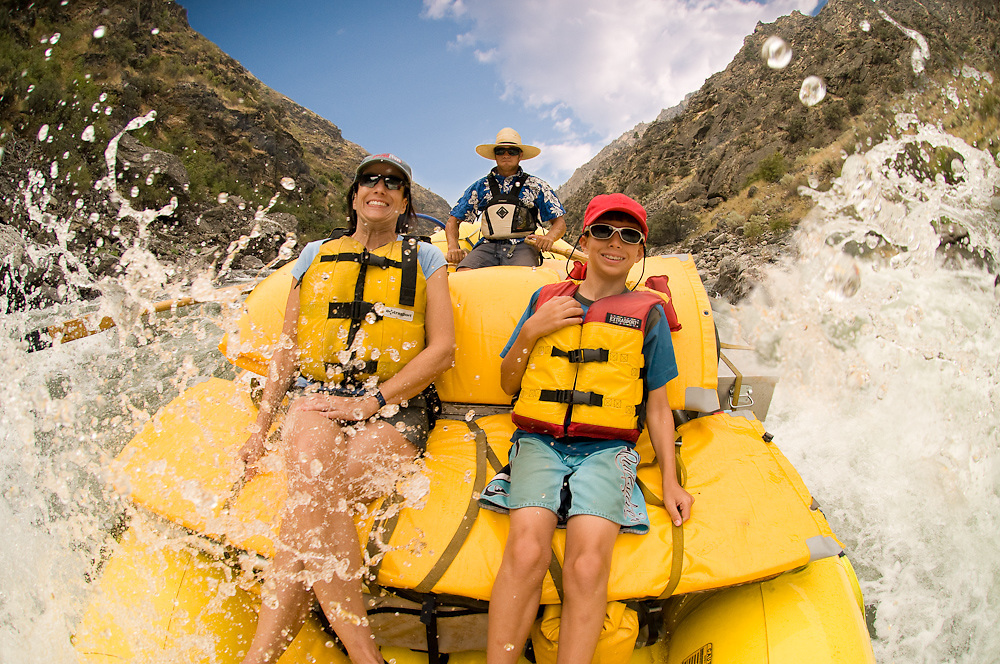 Idaho. Middle Fork Salmon River. Mother and son going through white water while on rafting trip. MR