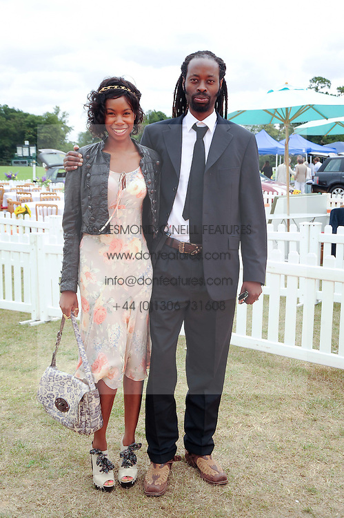 TALLULAH ADEYEMI and her brother KEMINDE ADEYEMI at the Veuve Clicquot Gold Cup polo final held at Cowdray Park, Midhurst, West Sussex on 18th July 2010.