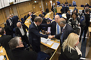 It's a YES, AFC Wimbledon Chief Executive Erik Samuelson gets congratulated at the planning application meeting to redevelop the Plough Lane site into a new 20,000 all seater stadium for AFC Wimbledon at Merton Civic Centre, Morden, United Kingdom on 10 December 2015. Photo by Stuart Butcher. The joint application is lodged by Galliard Homes and AFC Wimbledon.
