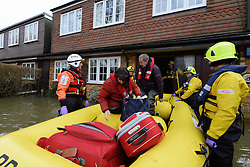 Residents in Wraysbury being rescued on a boat as the UK starts to sink, Wraysbury, United Kingdom, Tuesday, 11th February 2014. Picture by Andrew Parsons / i-Images