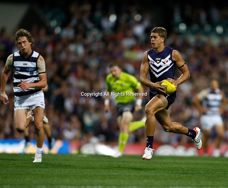 31.03.2012 Subiaco, Australia. Fremantle v Geelong. Stephen Hill runs with the ball during the Round 1 game played at  Patersons Stadium.