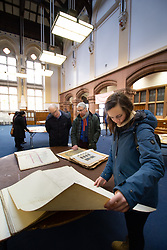 © Licensed to London News Pictures. 11/04/2018. Leicester, UK. Unseen original drawings and paintings of Leicester's most famous landmarks by eminent Victorian architect Joseph Goddard are to be displayed in public for the first time in history on 11 April 2018, to mark his 172th birthday. Pictured, visitors looking through the drawings on display in the banking hall. The exhibition will take in the iconic former bank building, currently owned by ISKCON, at 31 Granby Street.<br /> Joseph Goddard designed some of Leicester's most famous landmarks, including the Clock Tower, the Thomas Cook offices, and 31 Granby Street, the impressive former Midland bank building. Hundreds of bound books were donated to ISKCON in 2017 by the great grandsons of Goddard and now the exhibition will feature samples of original drawings and designs by the architect.  Photo credit: Dave Warren/LNP