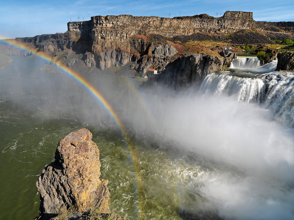 "Shoshone Falls is a waterfall on the Snake River located approximately five miles east of Twin Falls, Idaho. Sometimes called the ""Niagara of the West,"" Shoshone Falls is 212 feet (64.7 m) high—45 feet (14 m) higher than Niagara Falls—and flows over a rim 1,000 feet (305 m) wide. Shoshone Falls has existed at least since the end of the last ice age, when the Bonneville Flood carved much of the Snake River canyon and surrounding valleys. It is a total barrier to the upstream movement of fish. The falls were the upper limit of sturgeon, and spawning runs of salmon and steelhead could not pass the falls. Yellowstone cutthroat trout lived above the falls in the same ecological niche as Rainbow Trout below it. Due to this marked difference, the World Wide Fund for Nature used Shoshone Falls as the boundary between the Upper Snake and the Columbia Unglaciated freshwater ecoregions."