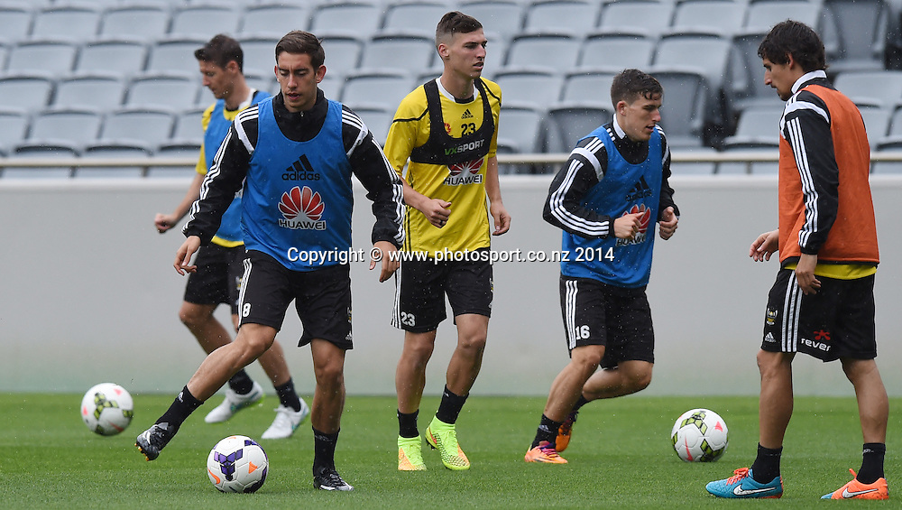 Players warm up. A-League Football. Wellington Phoenix training session at Eden Park, Friday 12 December 2014. Photo: Andrew Cornaga/photosport.co.nz