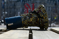 Brass bullet casings are glued to a bullhorn used at a anti-gun violence rally of students, and those who lost loved ones, at Love Park on Sunday exactly one year after the nationwide student-led protests to call for gun reform following the mass shooting in Parkland, FL. (Bastiaan Slabbers for WHYY)