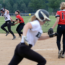 Staff photos by Tom Kelly IV<br /> Ridley's Heather Bogardus (12) is called out running between second and first bases for interference after colliding with Hatboro-Horsham shortstop Dee Moyer (13) on a hard hit ground ball from Jade Laughlin (9) during the Hatboro-Horsham at Ridley softball game on Monday afternoon.
