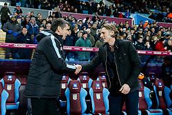 Aston Villa Manager Remi Garde greets Wycombe Wanderers Manager Gareth Ainsworth - Mandatory byline: Rogan Thomson/JMP - 19/01/2016 - FOOTBALL - Villa Park Stadium - Birmingham, England - Aston Villa v Wycombe Wanderers - FA Cup Third Round Replay.