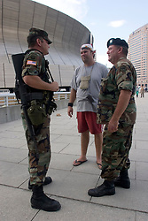31st August, 2005. New Orleans, Louisiana.<br /> The tourist saviour. Staff Sergeant Garland Ogden (rt) who saved tourists from 'Hell on earth.' with (mid) Anthony (Bud) Hopes and Spc Forest Vinson outside the Superdome in New Orleans, Louisiana where over 20,000 refugees from hurricane Katrina are crammed into hellish conditions. Bud Hopes, an Australian from Brisbane said, 'if it wasn't for Sgt Ogden's help we would never have made it out of the Superdome. It was hell in there. He has taken exceptional measures, above and beyond the call of duty, totally beyond the scope of his job, an exceptional man. He has the blessing of all the international tourists. it is incredible to think that so many of the armed forces here have lost their own homes and yet they are gathered here to help all these people. It is the most amazing thing I have seen ion all my life.'<br /> Bud Hopes has become the 'leader' of the band of some 50 or so trapped tourists, caught up in the hell that is Hurricane Katrina and her aftermath. Sgt Ogden said of Bud, 'if he was a soldier, he would have made an excellent general.' <br /> Bud Hopes' parents can be contacted in Australia. Contact Diane and Eric Hopes on 011 617 492 65646<br /> Photo Credit: Charlie Varley/varleypix.com