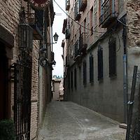 """Hostal Casa de Cisneros on Calle del Cardenal in Toledo, Spain, near """"la Puerta de los Leones de la Catedral de Toledo."""""""