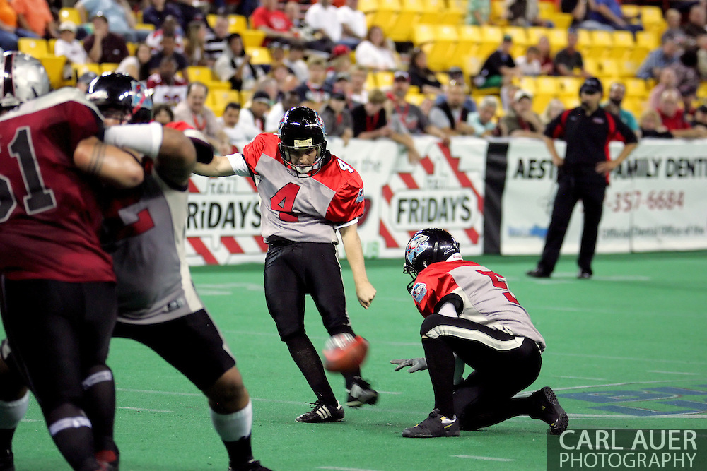 6-28-2007: Anchorage, AK - Barracuda kicker Kyle Robinson (4) goes for a point after as the CenTex Barracudas hand the Alaska Wild another loss 53-47 as the Barracudas make the trip up to Alaska.