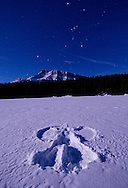 Snow Angel and stars on frozen lake near Banff Canada