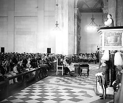 His Grace the Archbishop of Canterbury Geoffrey Fisher delivering his address of the Thanksgiving Service at St Paul's Cathedral. Seated behind King George VI and Queen Elizabeth are Queen Mary, Princess Elizabeth and other members of the Royal Family.