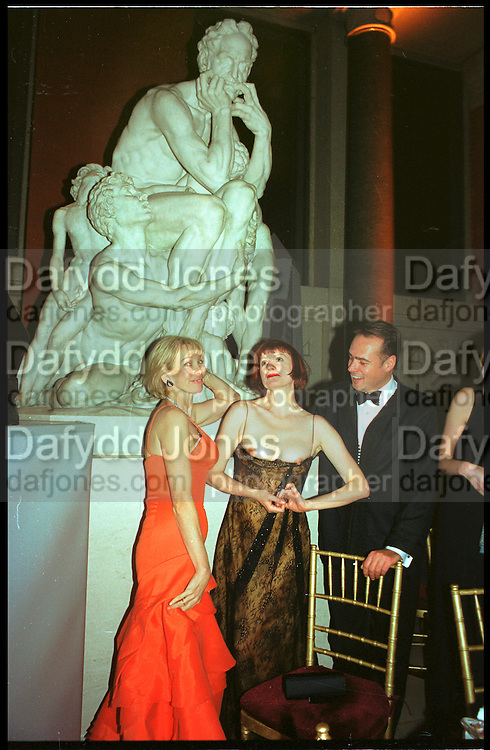 Trudie Styler and Nell Campbell (flashing). Costume Institute, Metropolitan Museum. 6 December 2003. © Copyright Photograph by Dafydd Jones 66 Stockwell Park Rd. London SW9 0DA Tel 020 7733 0108 www.dafjones.com