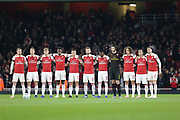 Arsenal players respecting a minute's silence before the EFL Cup 4th round match between Arsenal and Blackpool at the Emirates Stadium, London, England on 31 October 2018.
