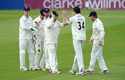 James Fuller of Gloucestershire celebrates as Colin Ingram of Glamorgan (30) is caught behind by Roderick from his bowl - Mandatory byline: Dougie Allward/JMP - 07966386802 - 22/09/2015 - Cricket - County Ground -Bristol,England - Gloucestershire CCC v Glamorgan CCC - LV=County Championship