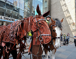 Joey, the life-sized puppet horse from the hit production of War Horse, arrived outside the Festival Theatre in Edinburgh, where he met up with police horse Lewis, ridden by PC Claire Hunter.<br /> <br /> © Dave Johnston/ EEm