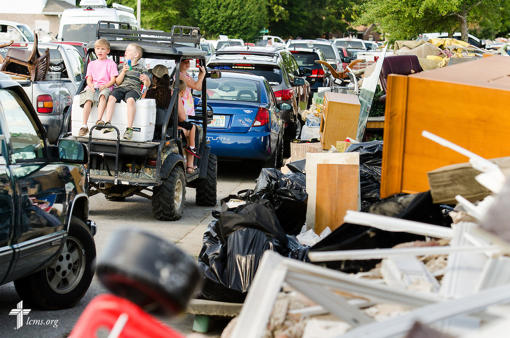 Traffic slows to a crawl in a flood-damaged neighborhood of Pensacola, Fla., on Saturday, May 3, 2014. LCMS Communications/Erik M. Lunsford