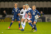 Erin Cuthbert (#22) (Chelsea) of Scotland shields the ball from Julie Ertz (#8) (Chicago Red Stars) of the USA during the Women's International Friendly match between Scotland Women and USA at the Simple Digital Arena, Paisley, Scotland on 13 November 2018.